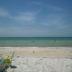 Photo taken at Coquina Beach by Therese G. on 5/6/2012