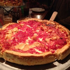 Photo taken at Chinnati's Pizza by Elizabeth M. on 3/4/2012