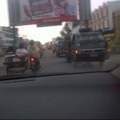 Photo taken at Jalan Medan-Binjai by Tengku Devi A. on 3/29/2012
