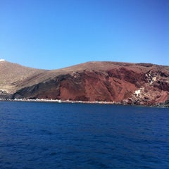Photo taken at Κόκκινη Παραλία (Red Beach) by Andrey M. on 8/14/2012