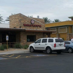 Photo taken at Wolfley's Neighborhood Grill by Bennett D. on 7/28/2012