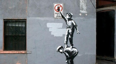 Photo of Public Art Banksy :: #1 The street is in play at 18 Allen St, New York, NY 10002, United States