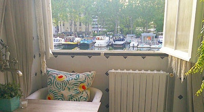 Photo of Cafe Le Pavillon des Canaux at 39 Quai De Loire, Paris 75019, France