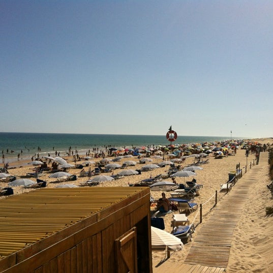 Photo taken at Praia do Barril by Rafael C. on 8/27/2012