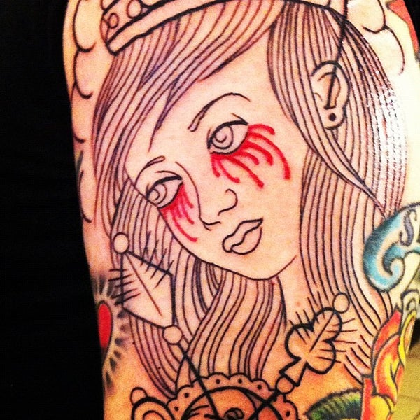 Photo taken at Let It Bleed Tattoo by r v. on 11/21/2011