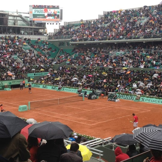Photo taken at Stade Roland Garros by Nathalie W. on 6/11/2012