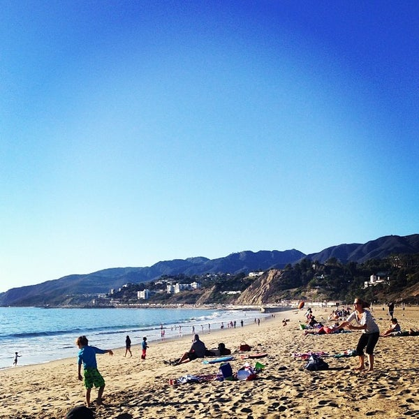 Photo taken at Pacific Palisades Beach by Teresa L. on 12/31/2013