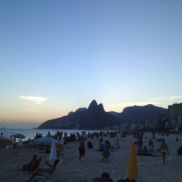 Photo taken at Praia de Ipanema by Well S. on 3/14/2014