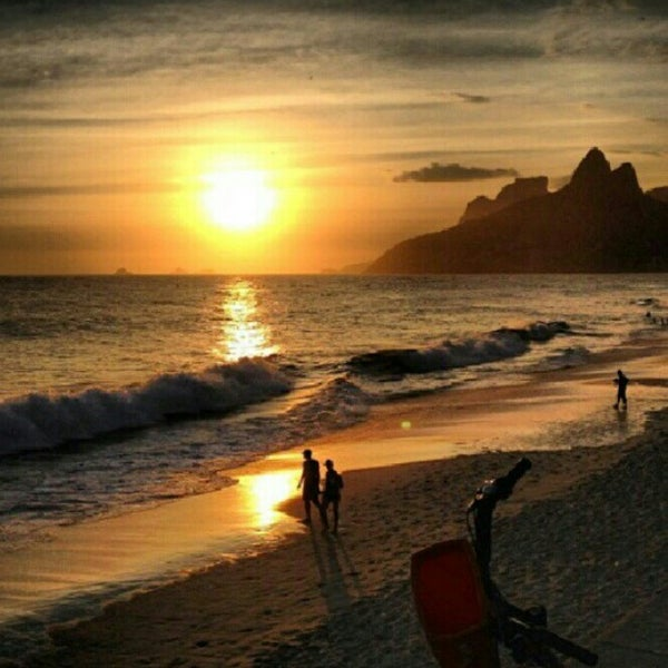Photo taken at Praia de Ipanema by Ariele M. on 7/22/2013