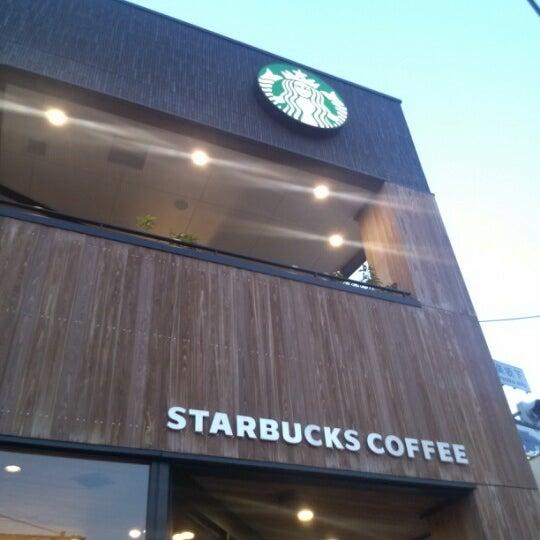Photo taken at Starbucks Coffee 神楽坂下店 by Yoshihisa Y. on 10/21/2012