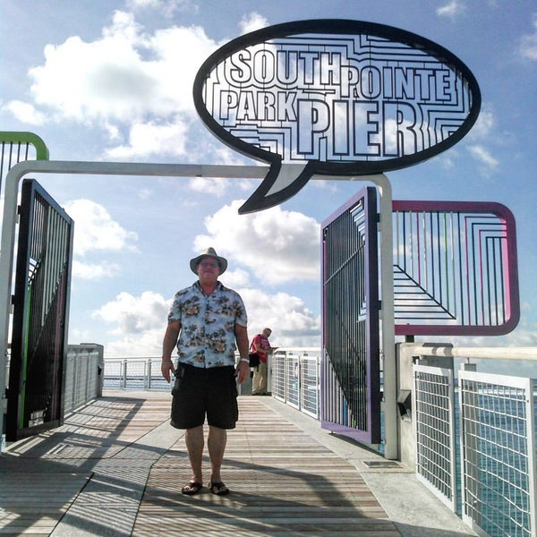 Photo taken at South Pointe Pier by CamelotSuper S. on 9/30/2015