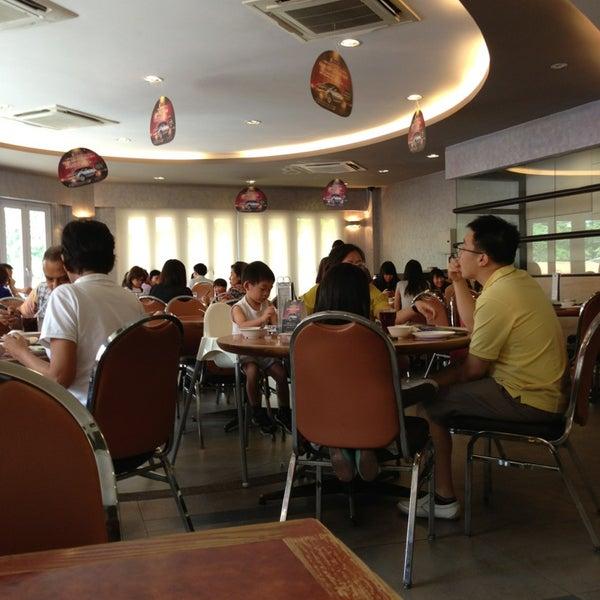 Photo taken at Crystal Jade Kitchen 翡翠小厨 by John T. on 6/12/2013