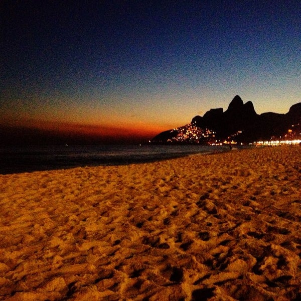 Photo taken at Praia de Ipanema by Heron M. on 6/25/2013