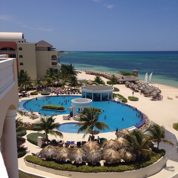 Photo taken at Iberostar Rose Hall Suites by Theada P. on 8/8/2014