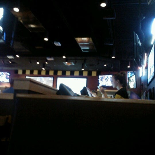 Photo taken at Buffalo Wild Wings by Kuanesha C. on 10/7/2012