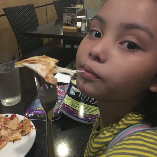 Photo taken at California Pizza Kitchen by Carlo C. on 5/6/2016