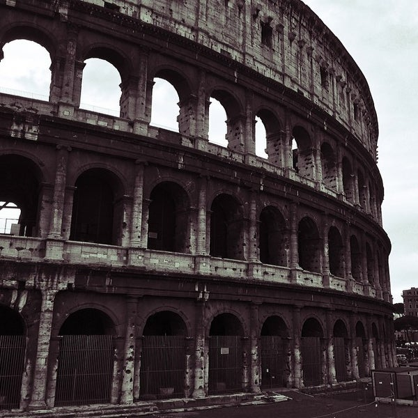 Photo taken at Piazza del Colosseo by Eirik L. on 2/28/2014