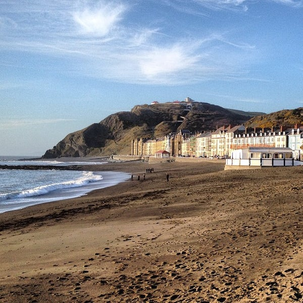 Photo taken at Aberystwyth Beach by Max R. on 4/18/2013