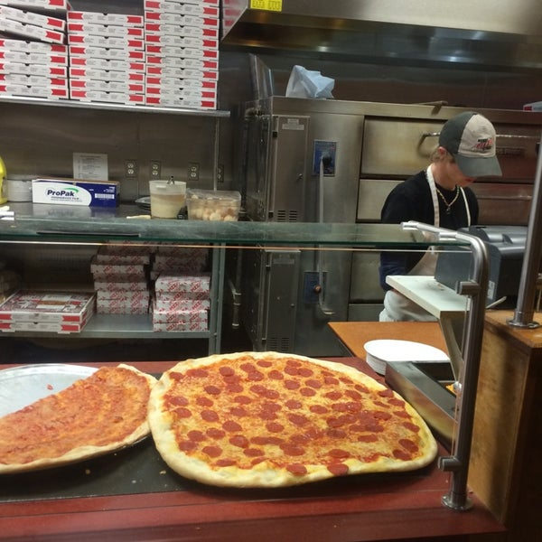 Photo taken at Burke Street Pizza by Anthony B. on 7/16/2014