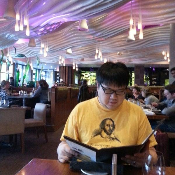 Photo taken at Glow Restaurant by Heather C. on 4/1/2014