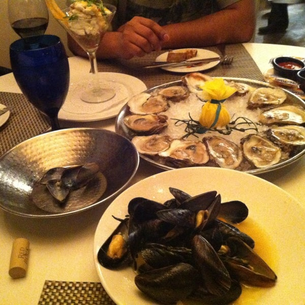 Photo taken at Catch 31 Fish House and Bar by Sumeer B. on 12/25/2012