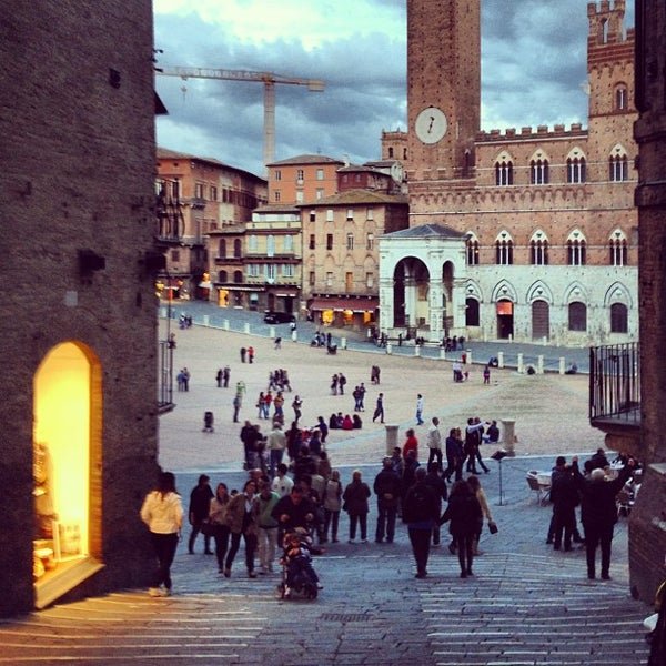 Photo taken at Piazza del Campo by Andre R. on 10/14/2012