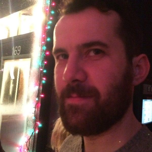 Photo taken at 11th Street Bar by Amanda C. on 12/12/2014