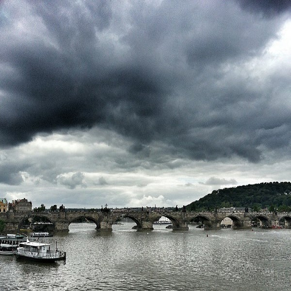 Photo taken at Charles Bridge by Helmie Z. on 5/23/2013
