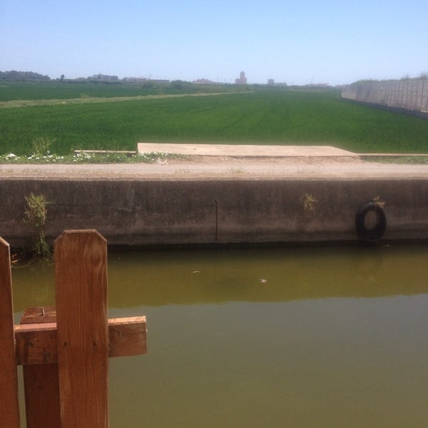 Photo taken at La Albufera by Almu R. on 7/5/2014