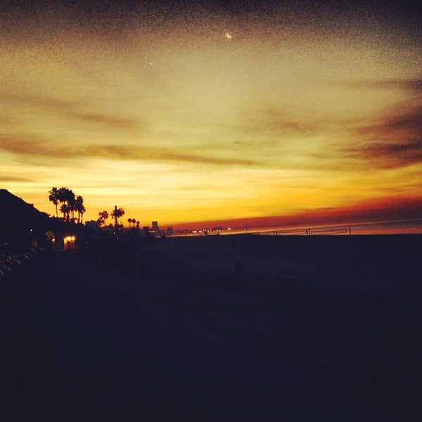 Photo taken at Pacific Palisades Beach by Ryan P. on 1/28/2014