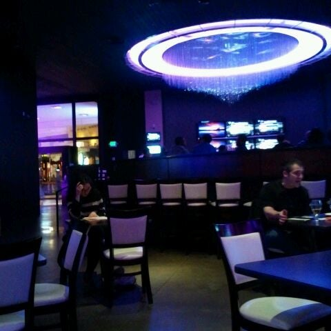 Photo taken at PNK Restaurant & Ultra Lounge by Andrea H. on 12/20/2011