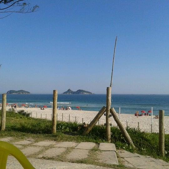 Photo taken at Praia da Barra da Tijuca by Priscilla C. on 12/7/2012