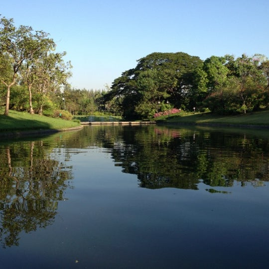 Photo taken at Queen Sirikit Park by Noppadol N. on 12/21/2012