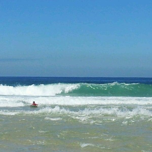 Photo taken at Praia da Barra da Tijuca by Eduardo V. on 3/31/2013
