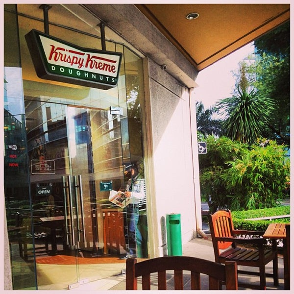 Photo taken at Krispy Kreme by Raymond S. on 8/21/2013
