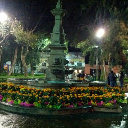 Photo taken at Jardín Hidalgo by Vladi on 11/4/2012