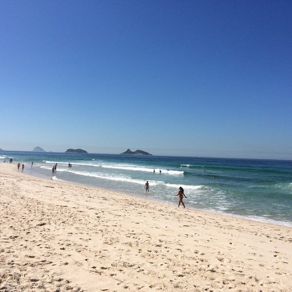 Photo taken at Praia da Barra da Tijuca by Juliana A. on 3/15/2014