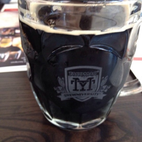 Photo taken at Taco Mac Sports Grill by Wes C. on 10/4/2014