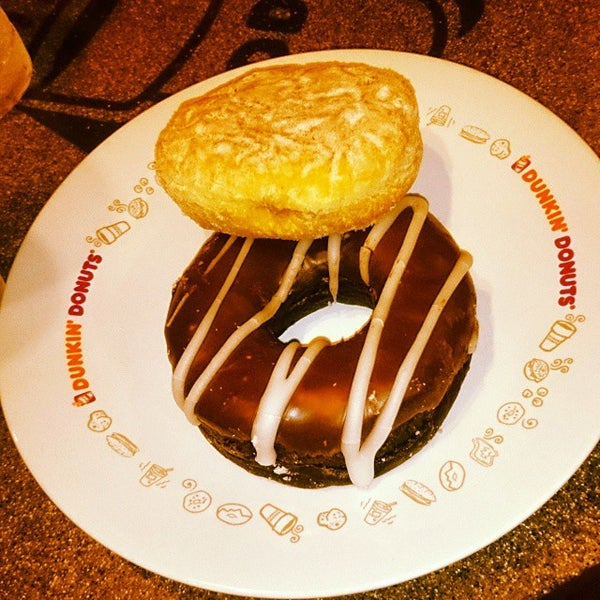 Photo taken at Dunkin' Donuts by Cypriana D. on 10/11/2014