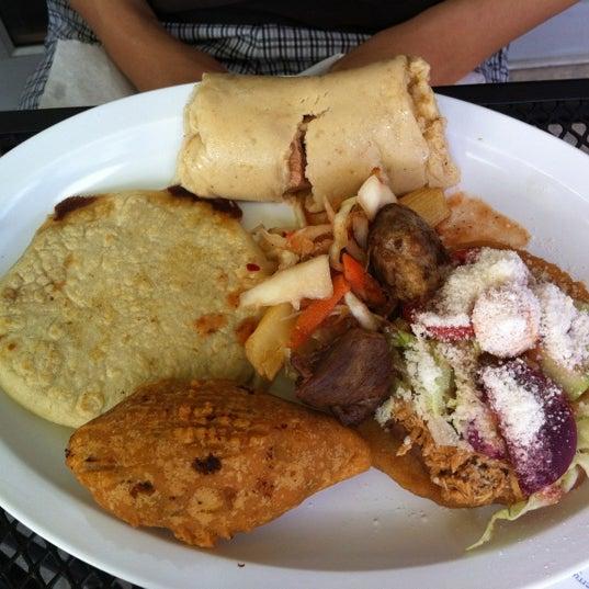 Photo taken at El Salvadoreño by Alex A. on 9/15/2012