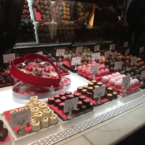 Photo taken at Godiva Chocolatier by Manuela G. on 2/1/2013