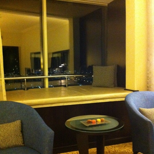 Photo taken at Towers Rotana Hotel by Junji K. on 10/6/2012