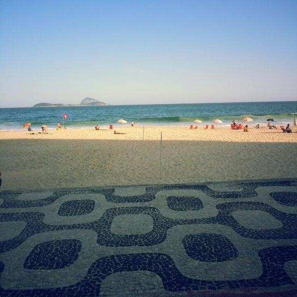 Photo taken at Praia de Ipanema by Augusto S. on 4/11/2013