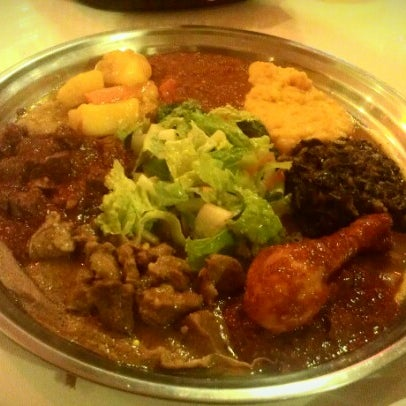 Photo taken at New Eritrea Restaurant & Bar by Angela P. on 1/22/2013