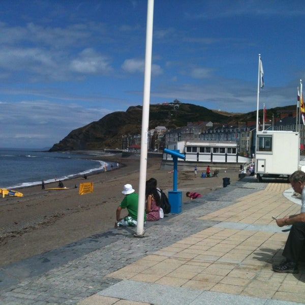 Photo taken at Aberystwyth Beach by John Paul G. on 7/30/2013