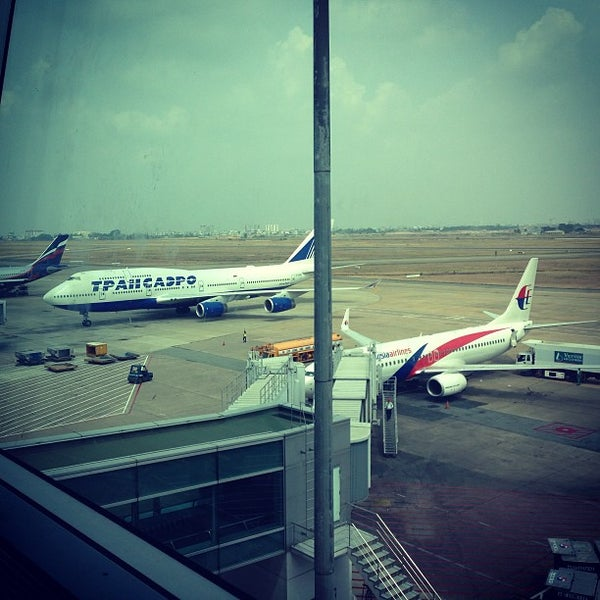 Photo taken at Tan Son Nhat International Airport (SGN) by Катерина К. on 4/8/2013