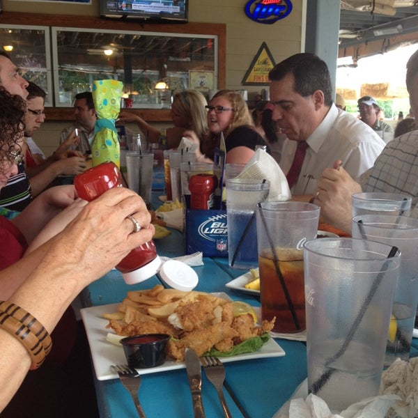 Photo taken at Fish Tales Lakeside Grille by Cindy S. on 6/29/2014