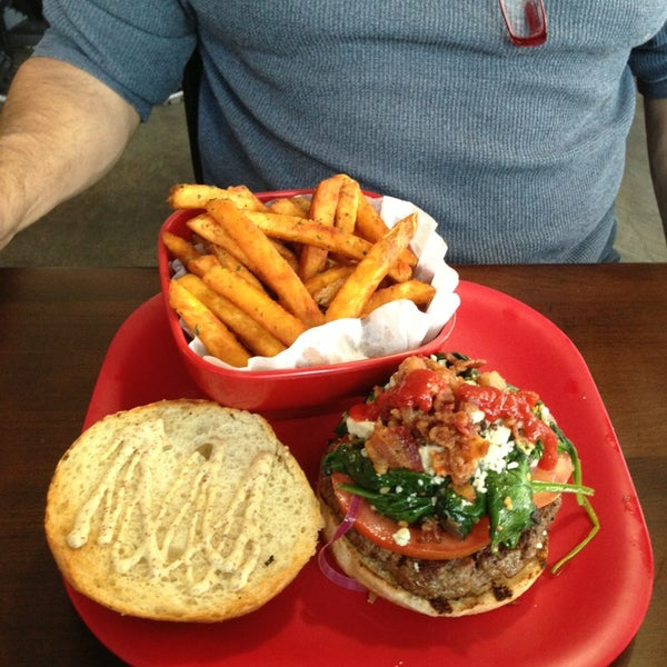 Photo taken at G Burger by Sally S. on 3/9/2013