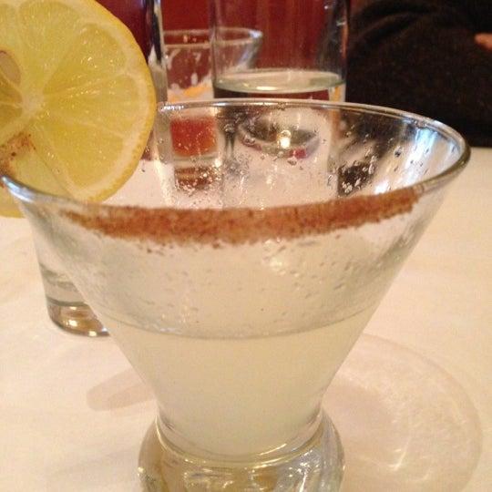 Photo taken at Village California Bistro & Wine Bar by Kim A. on 12/15/2012