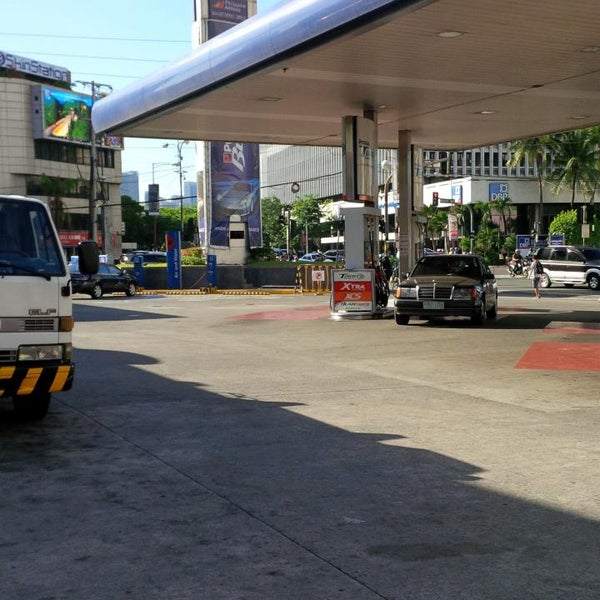 Photo taken at Petron by Ikkin J. on 6/27/2014